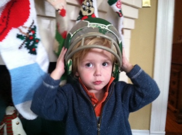 In honor of my beloved Eagles and Andy Reid's departure...the hand painted helmet of my youth modeled by one of our little Iggles.